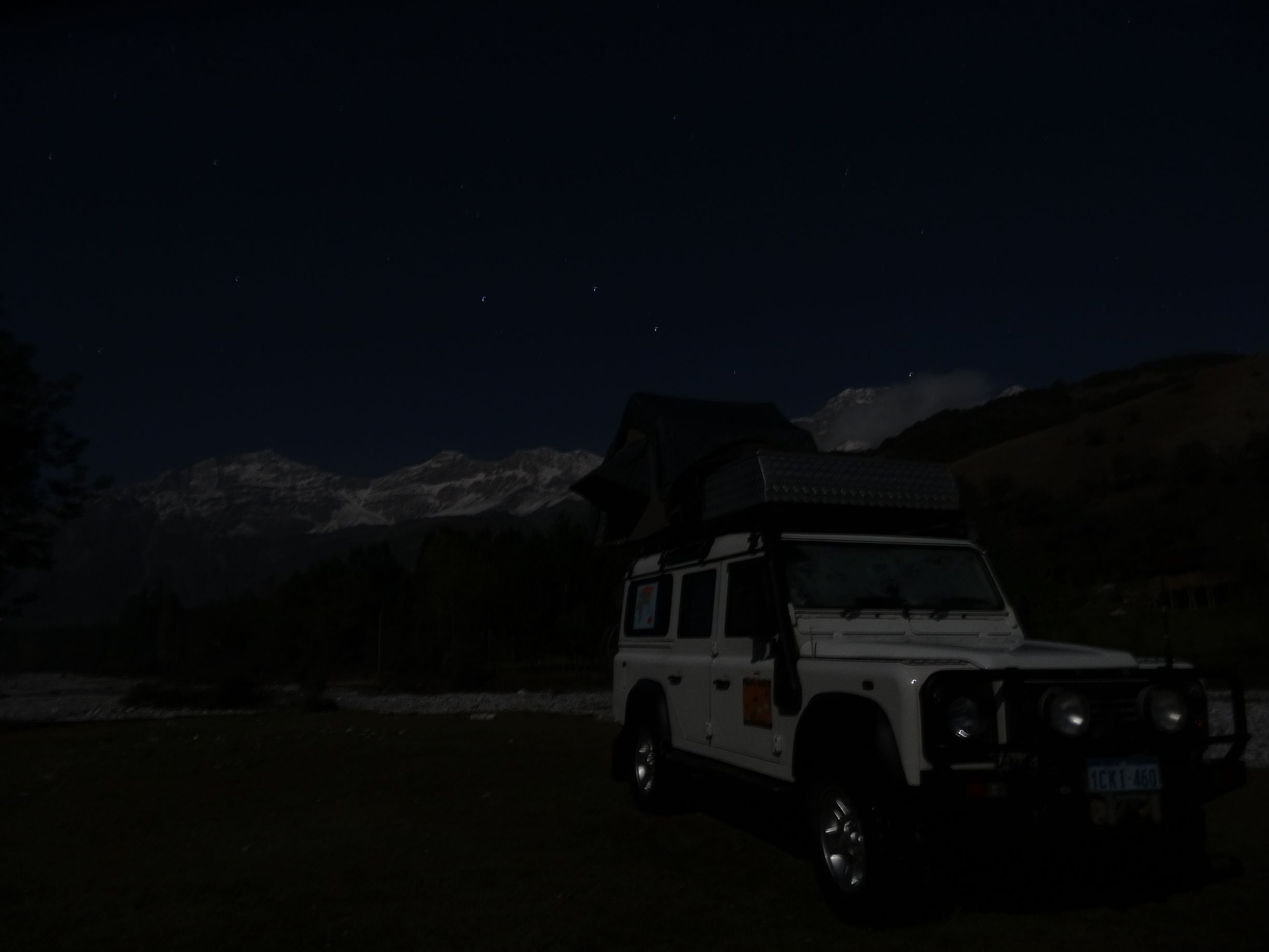 campsite under the stars and snowcapped mountains at Arslanbob