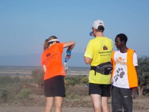 adding more water to our drinking bottles at each water stop (every 4km) for ease of drinking