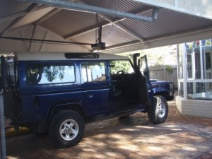 Lara under the carport, she fits without roof rack and tent on top
