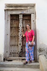 Regine next to one of the Zanzibar doors in Stone Town