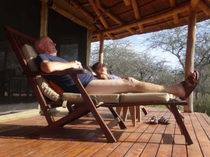 Nico and Riet snoozing on the deck of their tent in Tarangire NP