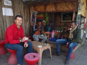 Jon, Habtamu and Abiy warming up with a freshly-brewed cup of coffee