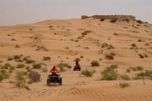 Jude riding a quad bike in the Sahara